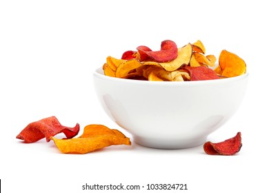 Bowl of mixed healthy vegetable chips. Side view, isolated on a white background.