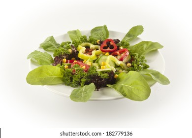 bowl of mixed salad against a white background