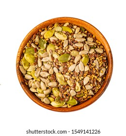 Bowl with mixed seeds for healthy eating on a white background