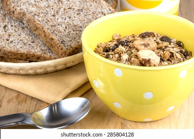 A bowl of muesli cereal and high fiber bread