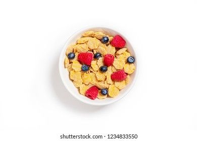 bowl of multigrain cornflakes and berries.  cereal with blueberries and raspberries. healthy breakfast. isolated on white background. top view