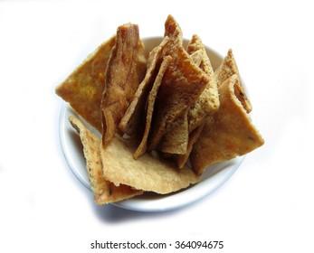 Bowl of multi-grain pita chips on white
