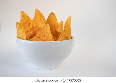 Bowl with nachos on a white background