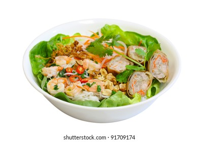 Bowl of noodle with eggroll, shrimp, and vegetable