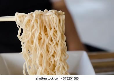 bowl of noodles on wooden table.