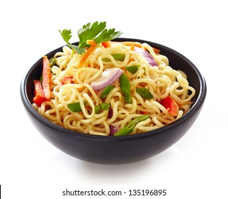 bowl of noodles with vegetables isolated on white