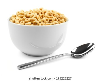 Bowl of oat cereal with spoon on a white background
