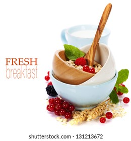 bowl of oat flake, berries and fresh milk on white background - health and diet concept (with easy removable sample text)