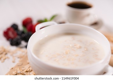 Bowl of oats breakfast cereal with milk in a close up cropped view conceptual of a healthy diet