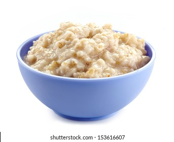 Bowl of oats porridge isolated on a white background. Healthy breakfast