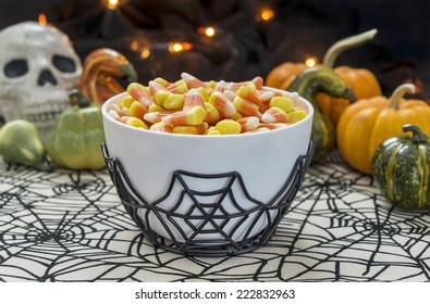 Bowl of old fashioned candy corn in a dimly lit spooky Halloween themed still life