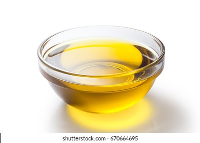 A bowl of olive oil on white background