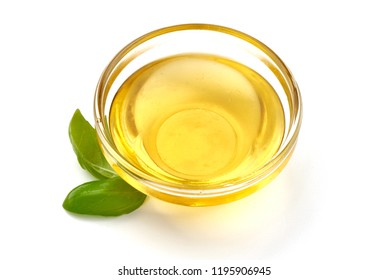 Bowl with olive or vegetable oil with basil leaves