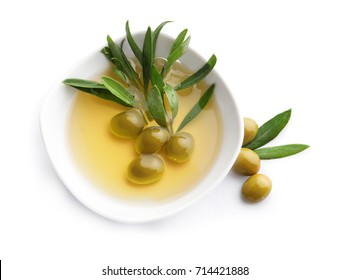 Bowl with olives and oil on white background