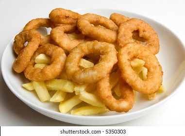 A bowl of onion rings and french fries