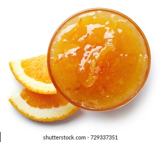 Bowl of orange jam isolated on white background from top view