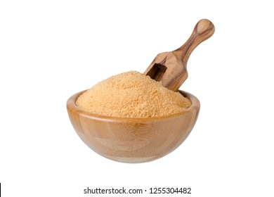 bowl with organic coconut sugar and wooden scoop isolated on white
