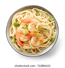 Bowl os spaghetti and fried prawns isolated on white background, top view