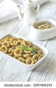 Bowl of pasta with pesto sauce