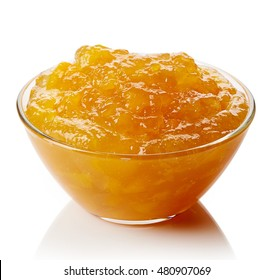Bowl of peach jam isolated on white background