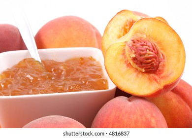 bowl of peach jam and some fresh fruits