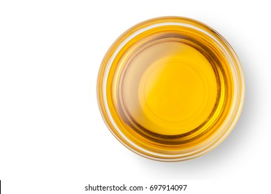 A bowl of peanut oil isolated on white background. Top view.