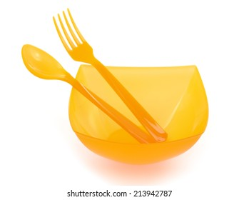bowl and plastic cutlery isolated on white background