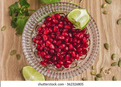 Bowl of Pomegranate Seeds with Lime and Cilantro