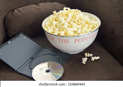 Bowl of Popcorn and a Movie on a Brown Chair