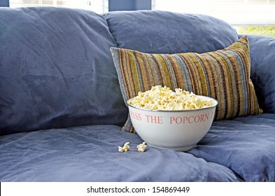 Bowl of Popcorn on a Blue Couch