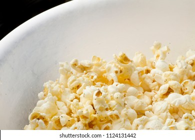 bowl of popcorn with some empty black space in upper left corner