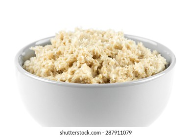 Bowl of porridge on white background. Healthy breakfast