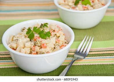 Bowl of potato salad and a fork on green  decorative napkin