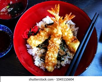 Bowl of prawn tempura donburi (Japanese don). Prawn tempura over Donburi rice. Shot from above. Prawn on rice. King Prawn Tempura.