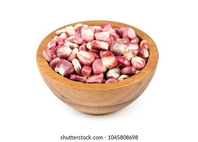 Bowl of purple hominy isolated on a white background