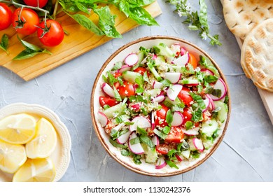 Bowl Of Quinoa Salad With Tomato Raddishes And Cucumbers