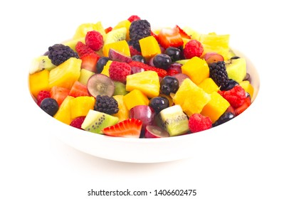 A Bowl of Rainbow Colored Fruit Salad Isolated on a White Background
