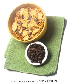 bowl of raisin bran cereal with extra raisins isolated