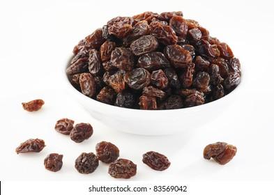 Bowl of raisin on white