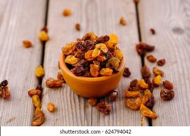 bowl of raisins. raisins on a wooden background.fresh raisin