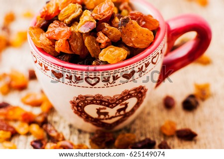 bowl of raisins. raisins on a wooden background.fresh raisin