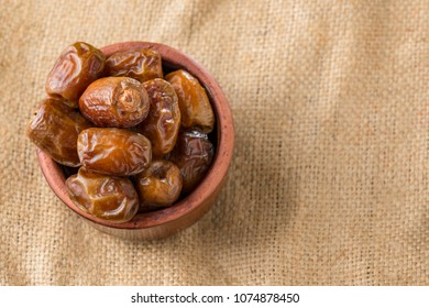 Bowl of Ramadan Dried Dates  on Vintage Background