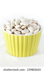 a bowl of raw butter beans