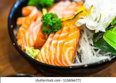 Bowl of raw slice salmon sashimi in japanese restaurant