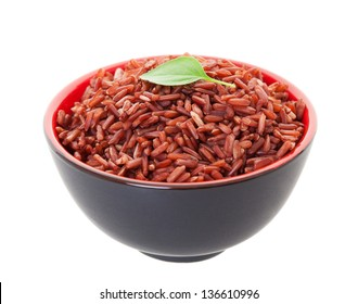 A bowl of Red Cargo Rice garnished with a single leaf of lemon basil.  Shot on white background.