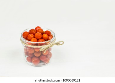 Bowl with red cherry tomato copy space