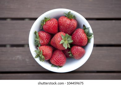 A bowl of red ripe strawberries.
