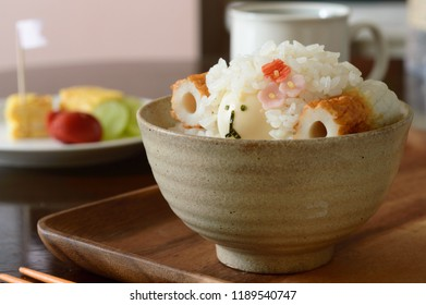 a bowl of rice elaborately decorated into a cute sheep