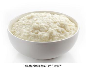 Bowl of rice flakes porridge isolated on a white background