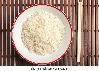 a bowl of rice on a bamboo mat